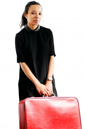 Nat Lue holding a suitcase